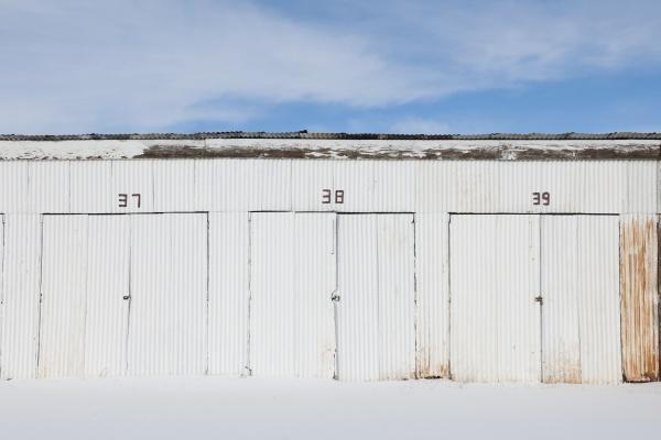nimbered doors on corrugated metal storage