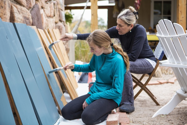 teenage girl and her mother painting