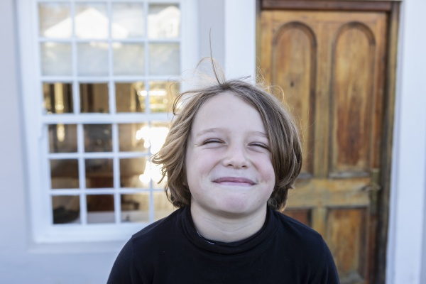 portrait of young boy posing outside