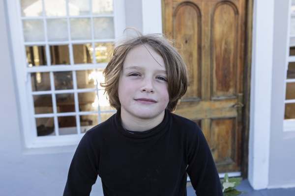 young boy outside his home portrait