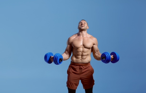 male muscular athlete with dumbbells in