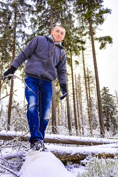 hiker in dying forest snowed in