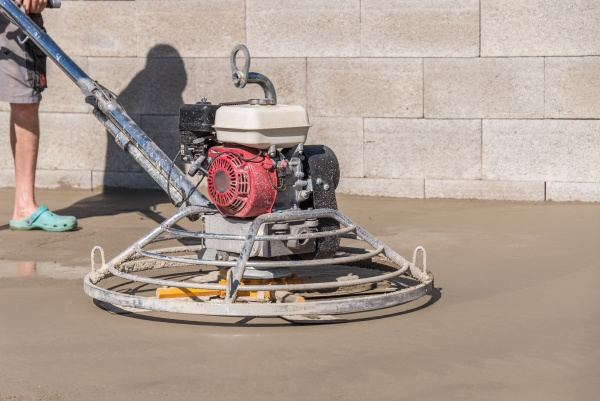 smoothing concrete with a concrete grinder