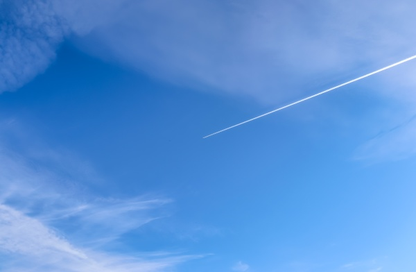 aircraft condensation contrails in the blue