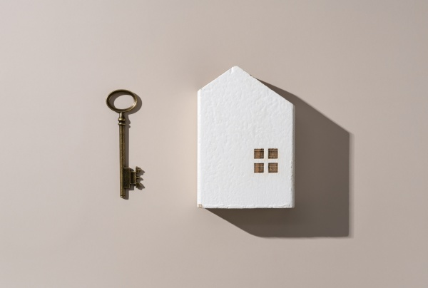 a brass key and a model