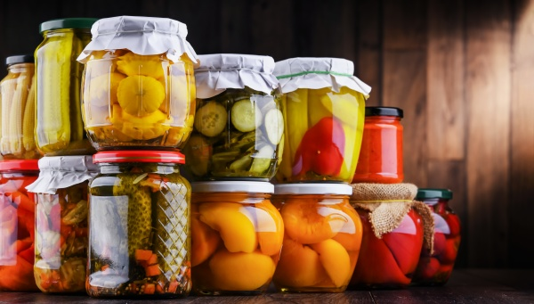 jars with variety of marinated vegetables