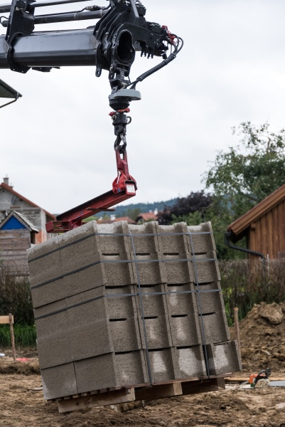 mobile crane delivers building materials to