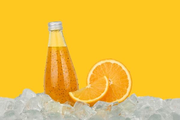 one glass bottle of orange drink