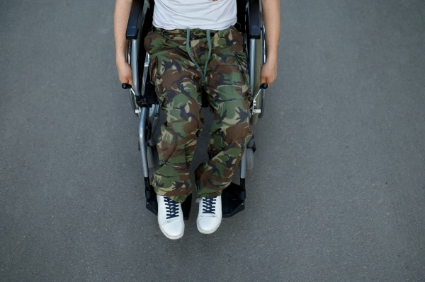 handicapped military person in wheelchair top
