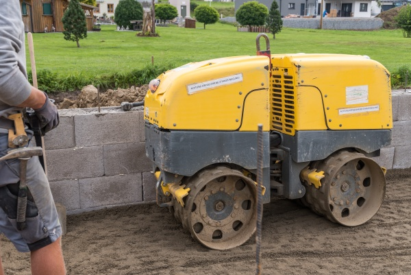 construction work with a trench roller