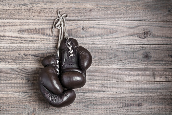 old boxing gloves on wooden wall