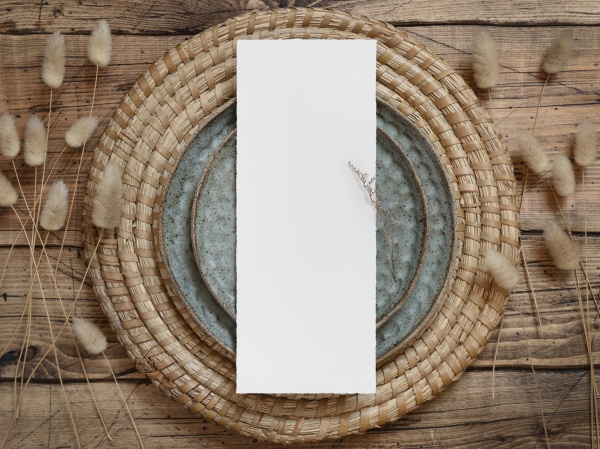 blank paper card on plates with