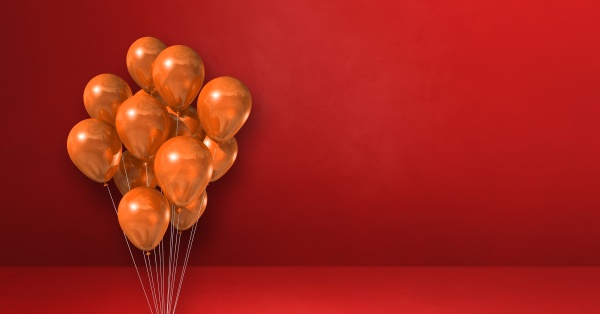 orange balloons bunch on a red