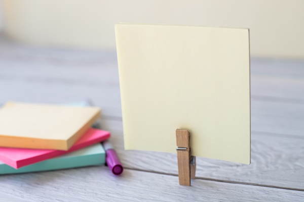 blank sticky note with laundry clip