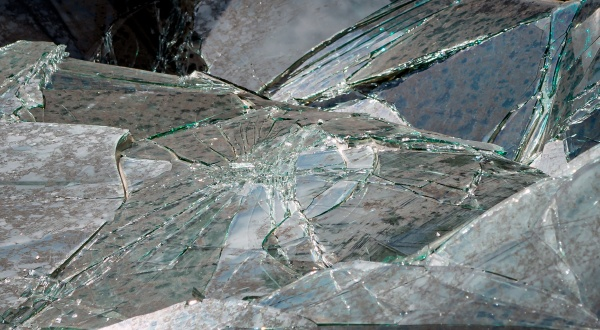 a broken windshield of the car