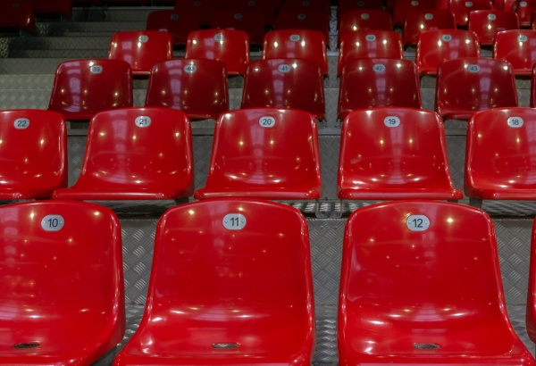 red plastic chairs in a stadium