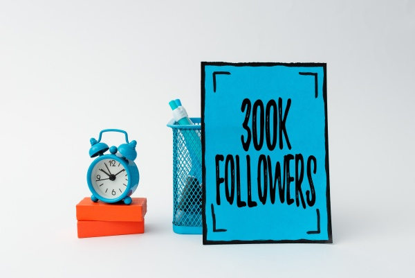 writing displaying text 300k followers concept