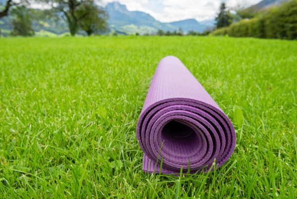 rolled up fitness mat on the