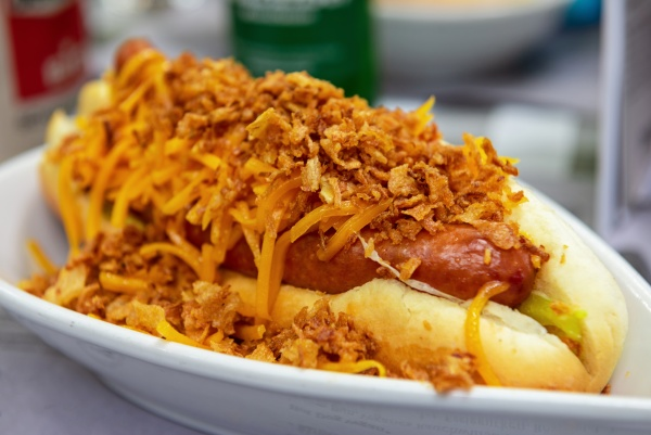 homemade hot dog with cheddar cheese