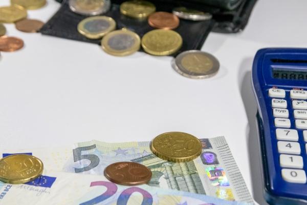 european money with black wallet on