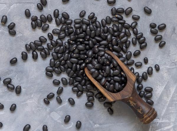 wooden scoop full of dry black