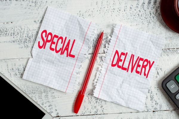 hand writing sign special delivery