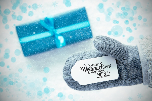gray glove turquoise gift label snowflakes