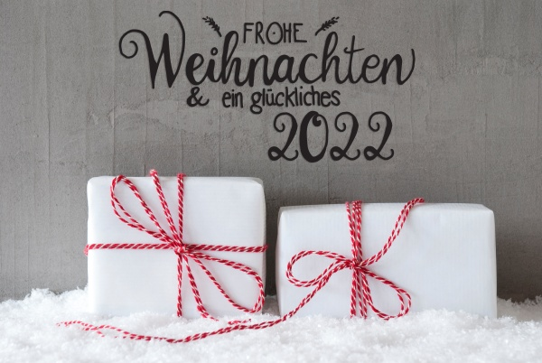 two white gifts snow cement glueckliches