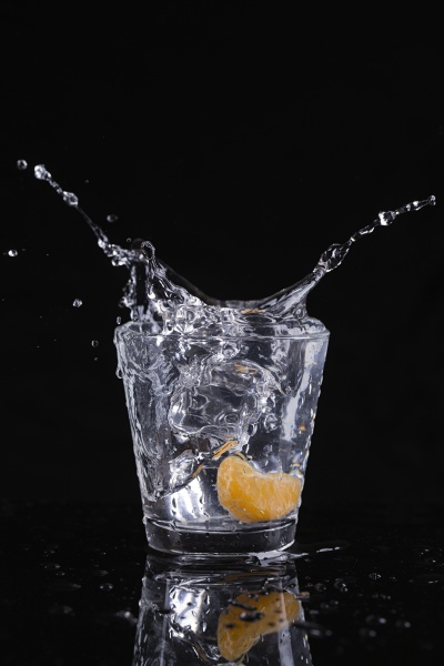 ice cubes splash into water with