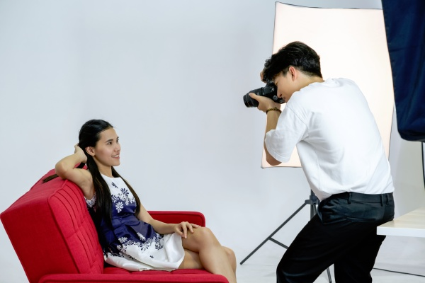 young asian photographer is photographing a