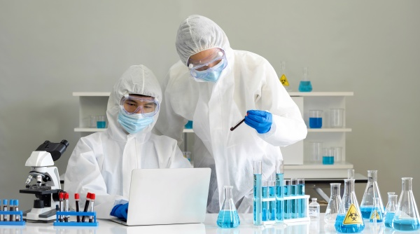 epidemiological researchers in virus protective clothing