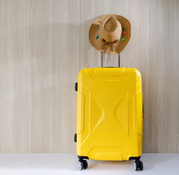 travel yellow baggate and straw cowgirl