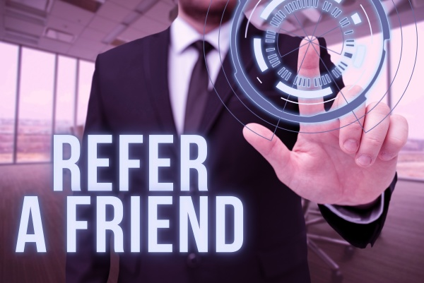 sign displaying refer a friend business
