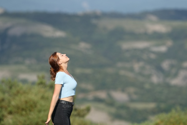 profile of a woman breathing fresh