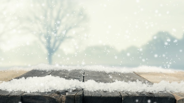 rustic wooden table with snow and