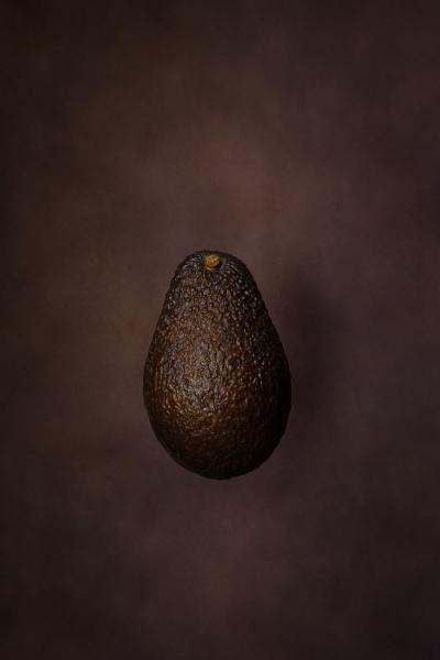 fresh avocado on dark background vegetarian