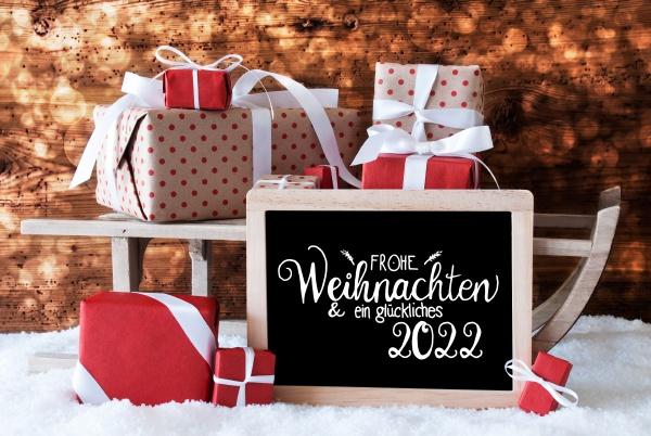 sleigh gift snow bokeh glueckliches 2022