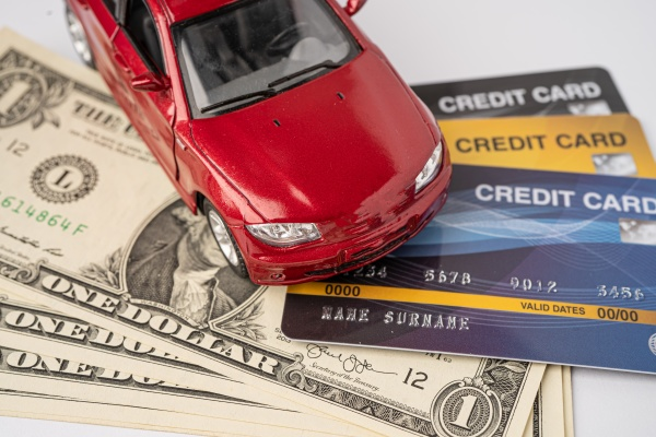red car on credit card and