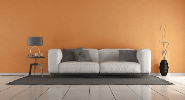 living room with orange wall and