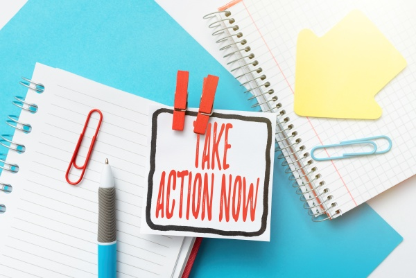 sign displaying take action now business