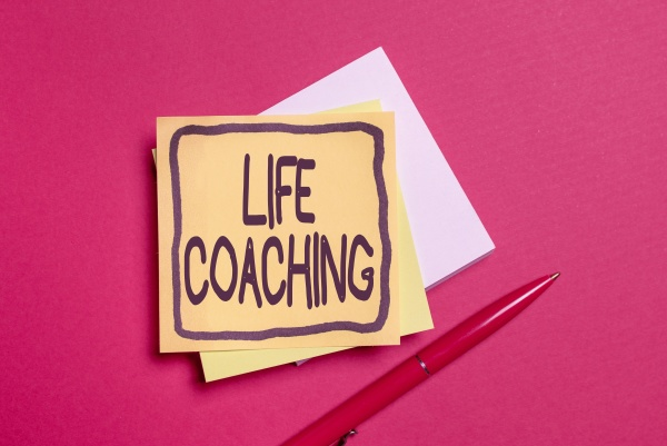 sign displaying life coaching word for