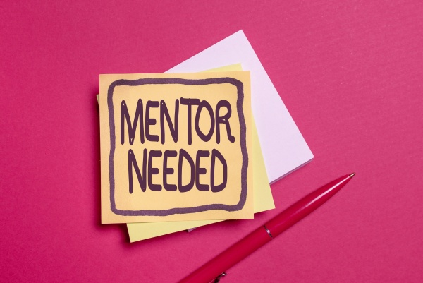 hand writing sign mentor needed word
