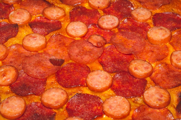 homemade pizza with many salami and