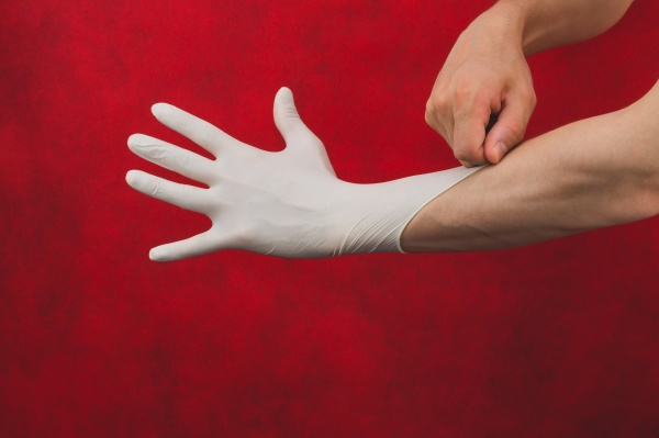 hand in medical glove on a