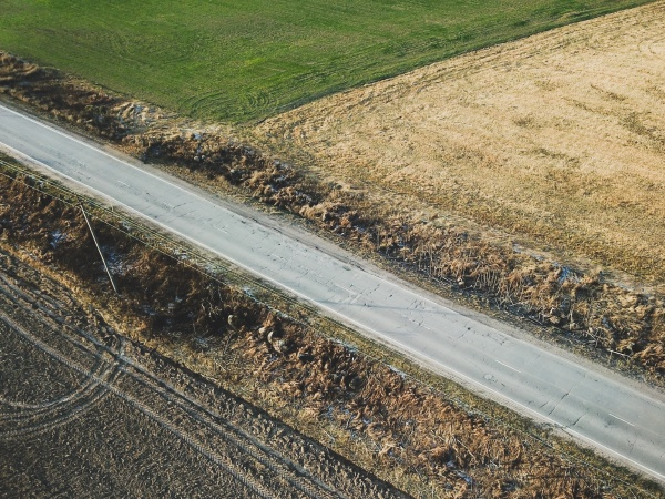 road and agricultural field aerial view