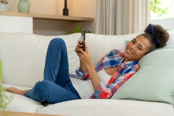 mixed race woman sitting on couch