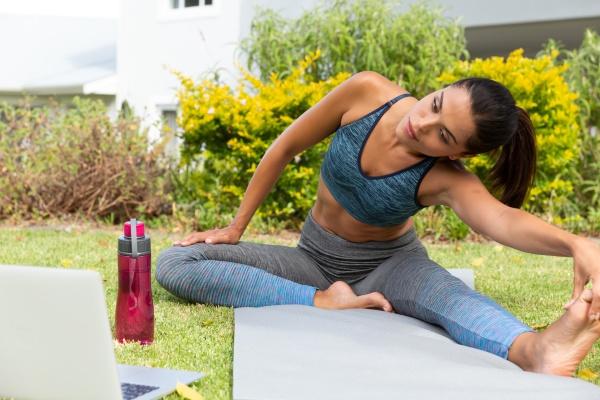 caucasian woman exercising practicing yoga and