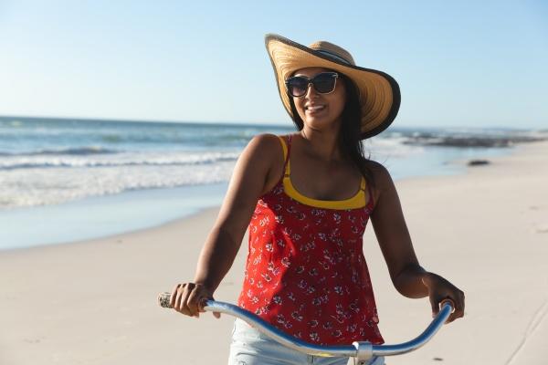 happy mixed race woman on beach