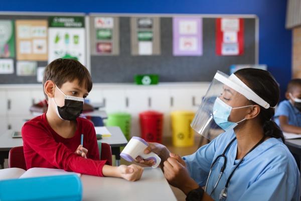 female health worker wearing face shield