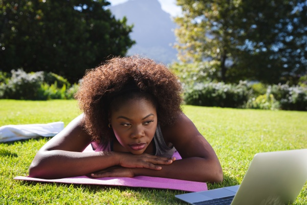 african american woman exercising lying on